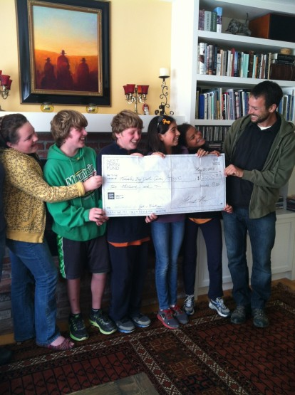 Tomales Bay Youth Center's Youth In Philanthropy YIPSters present funds they raised (and the Fund matched) to Chris Eckert of TBYC.